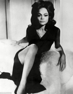 EARTHA KITT reclining in black
